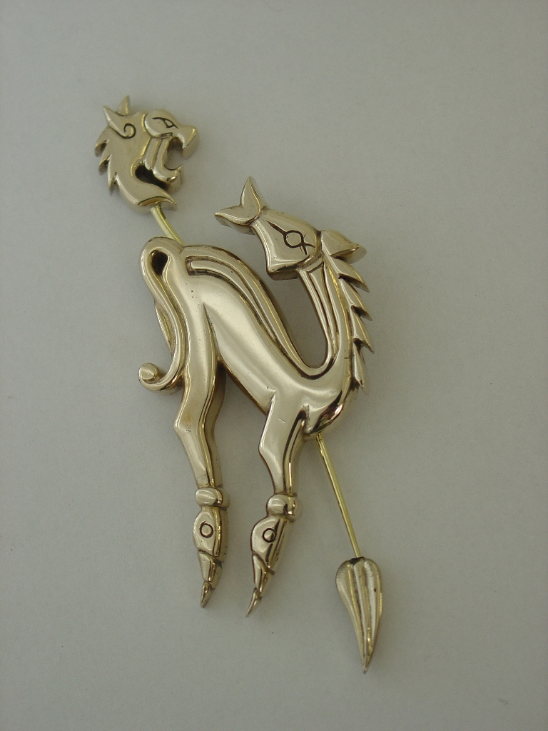 Cast bronze horse and beast pin