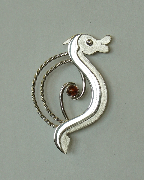 Silver animal brooch with amber