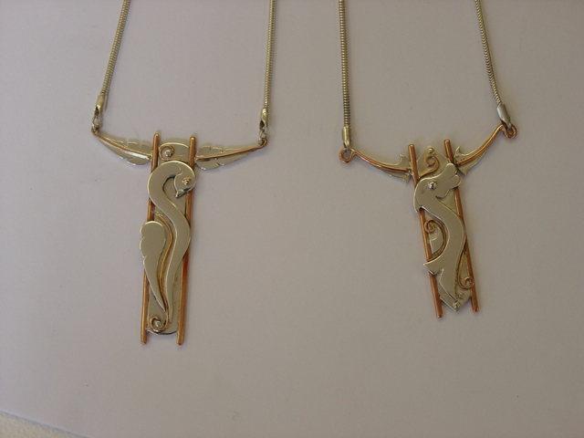 Long silver and copper pendants