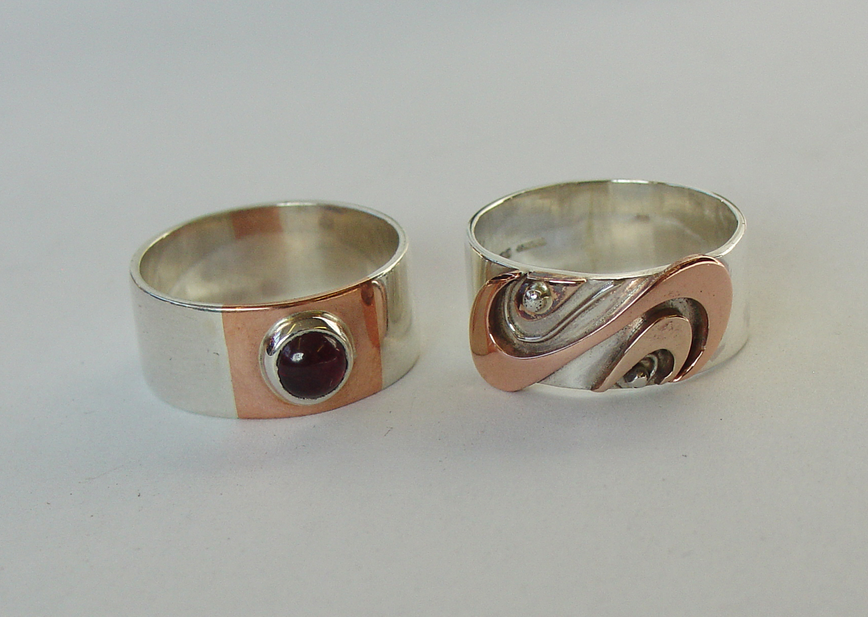 Silver, copper and garnet rings