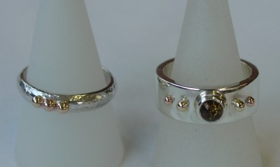 Silver, gold and amber rings
