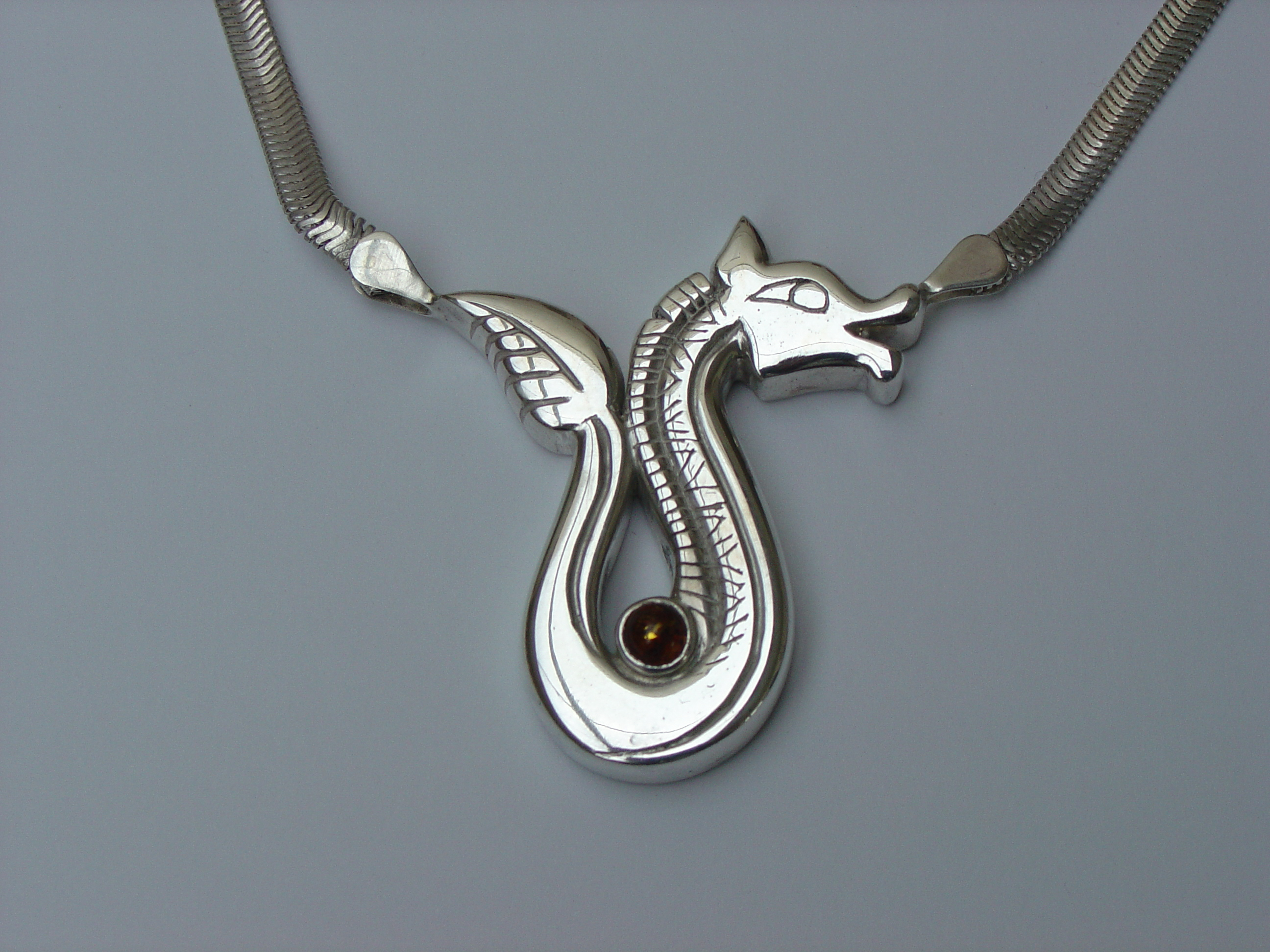 Pendants and neckpieces arkane jewellery silver animal with amber mozeypictures Images