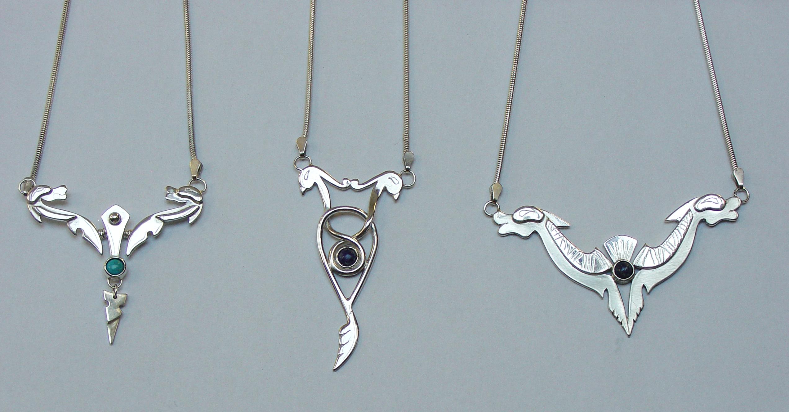 Silver pendants set with semi precious stones