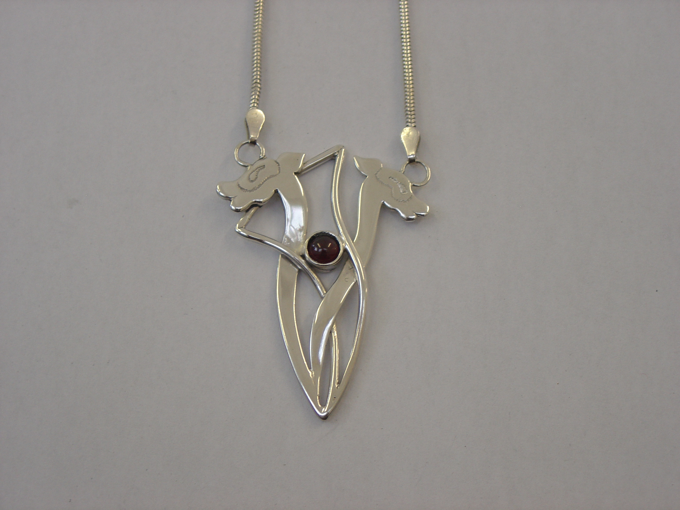 Silver animals with garnet