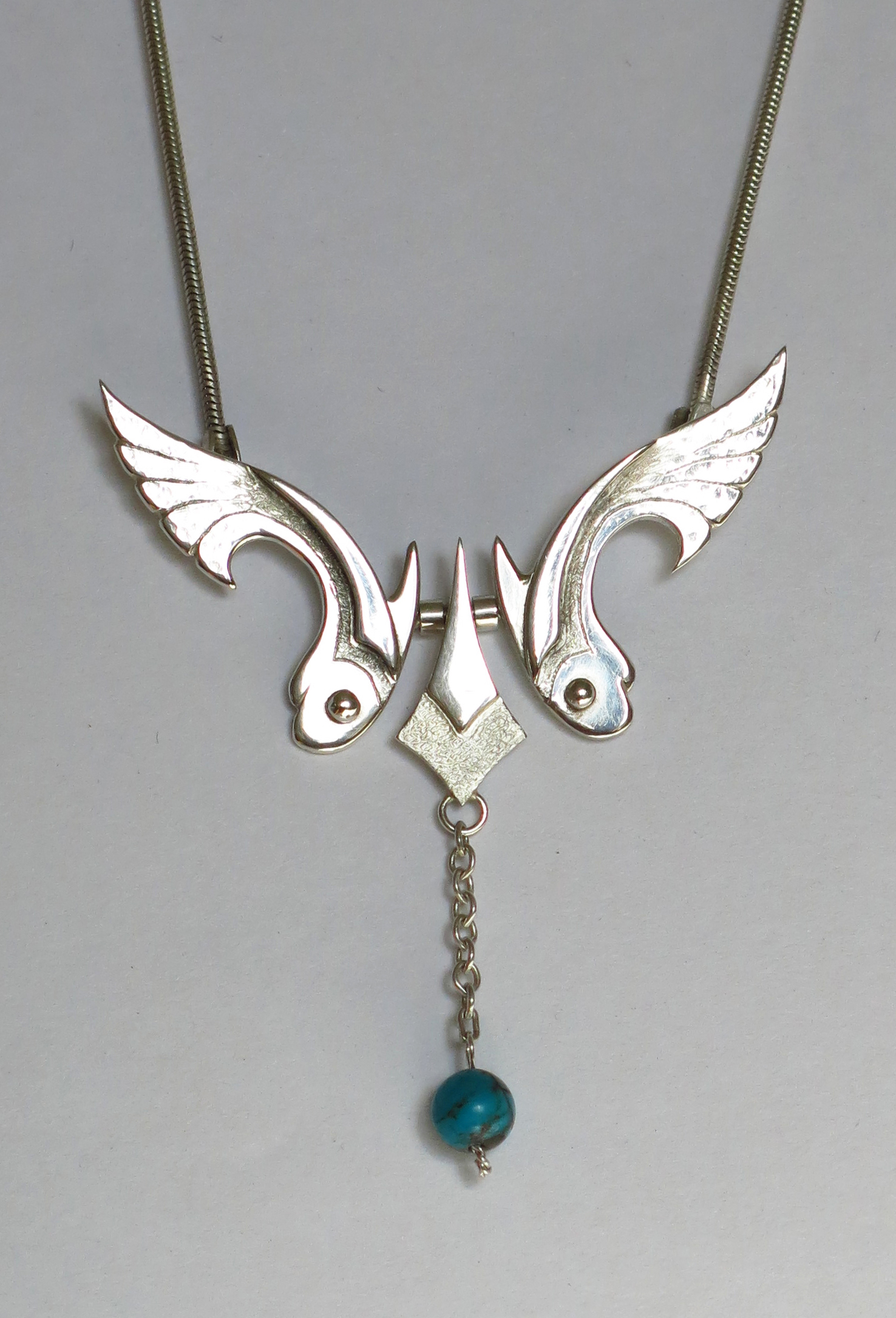 Silver fish with turquoise