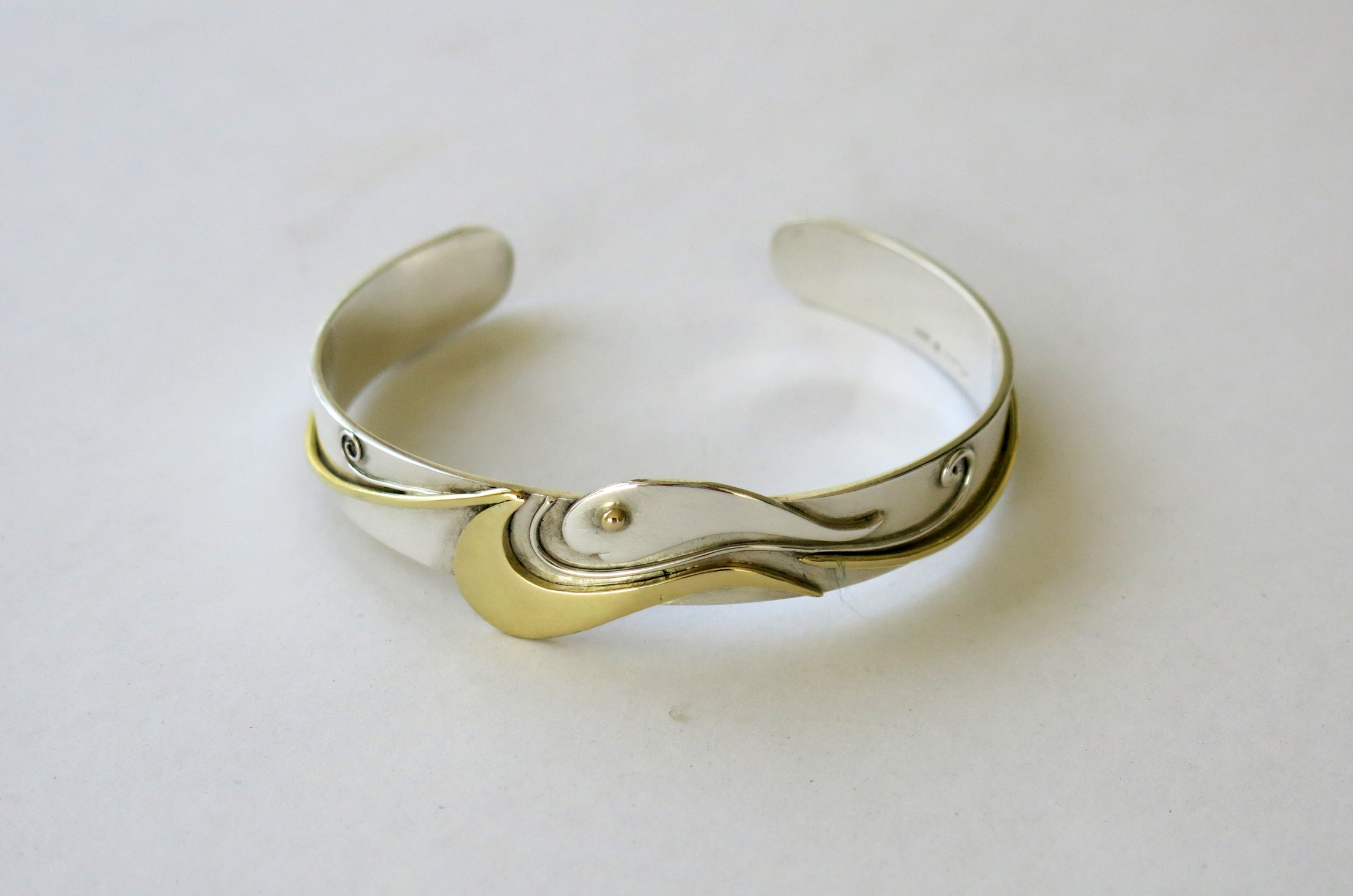Silver and brass fish bangle