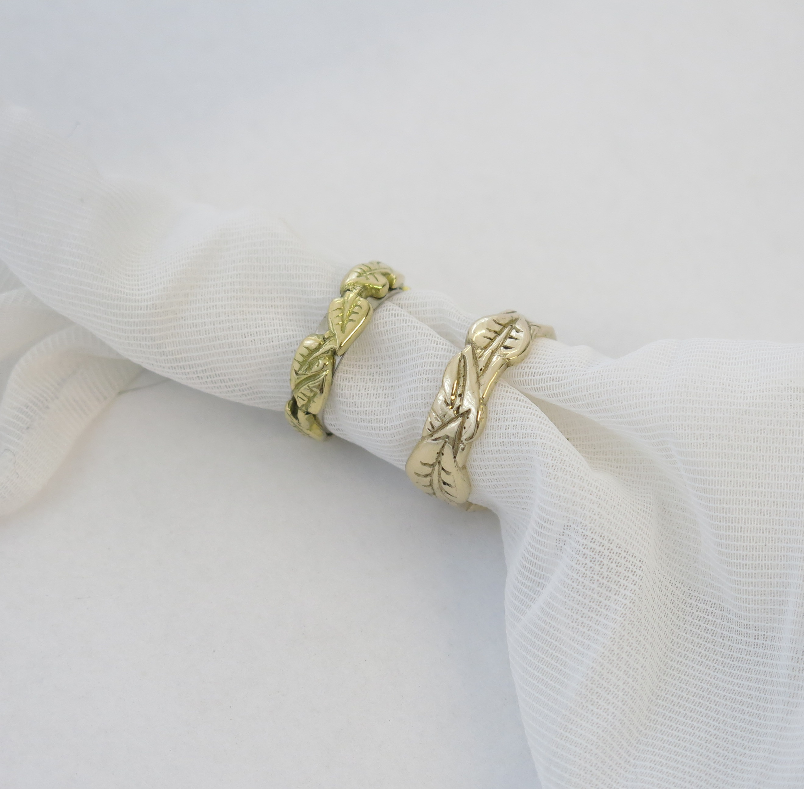 Gold wedding rings with leaf design