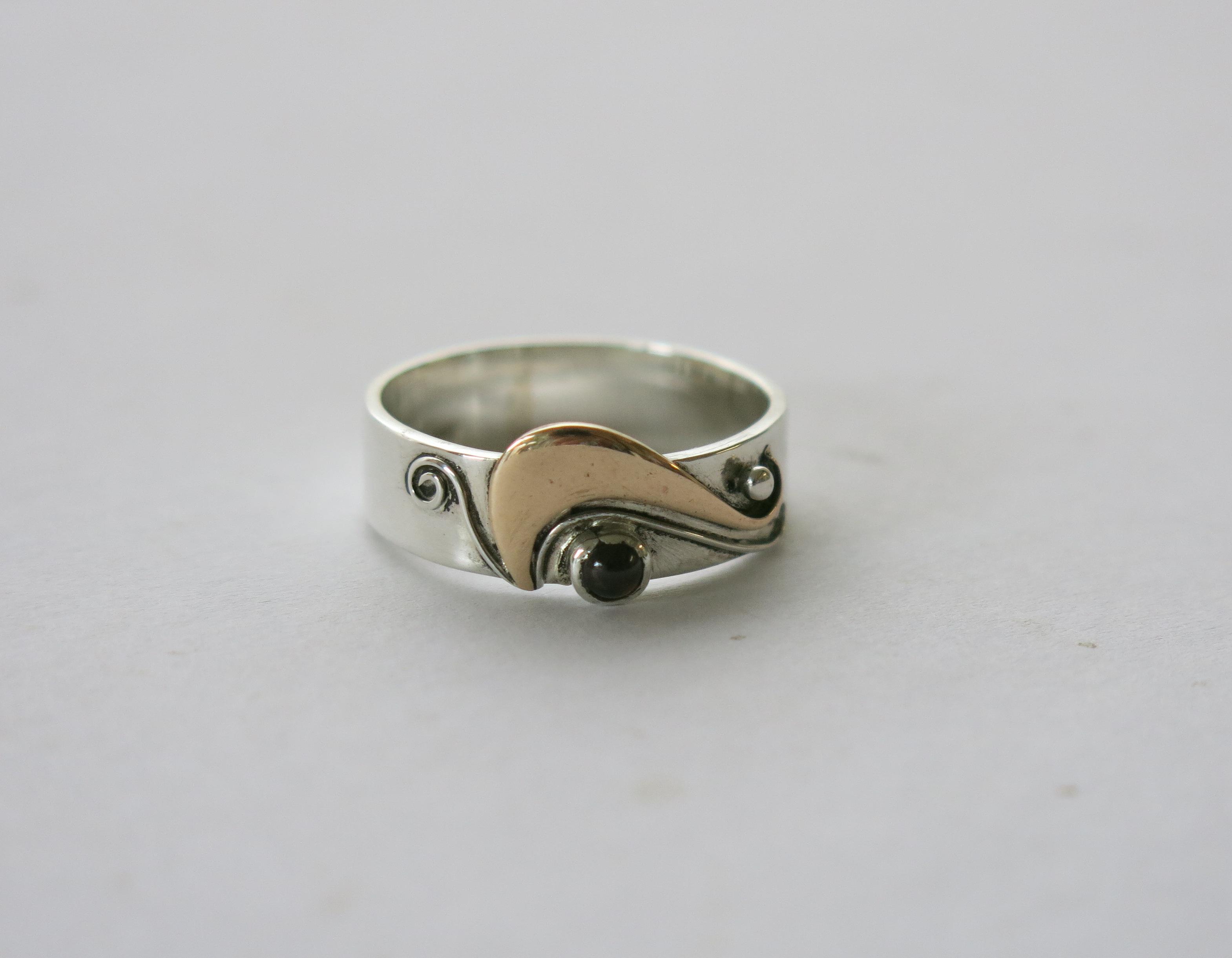 Silver,brass and garnet ring