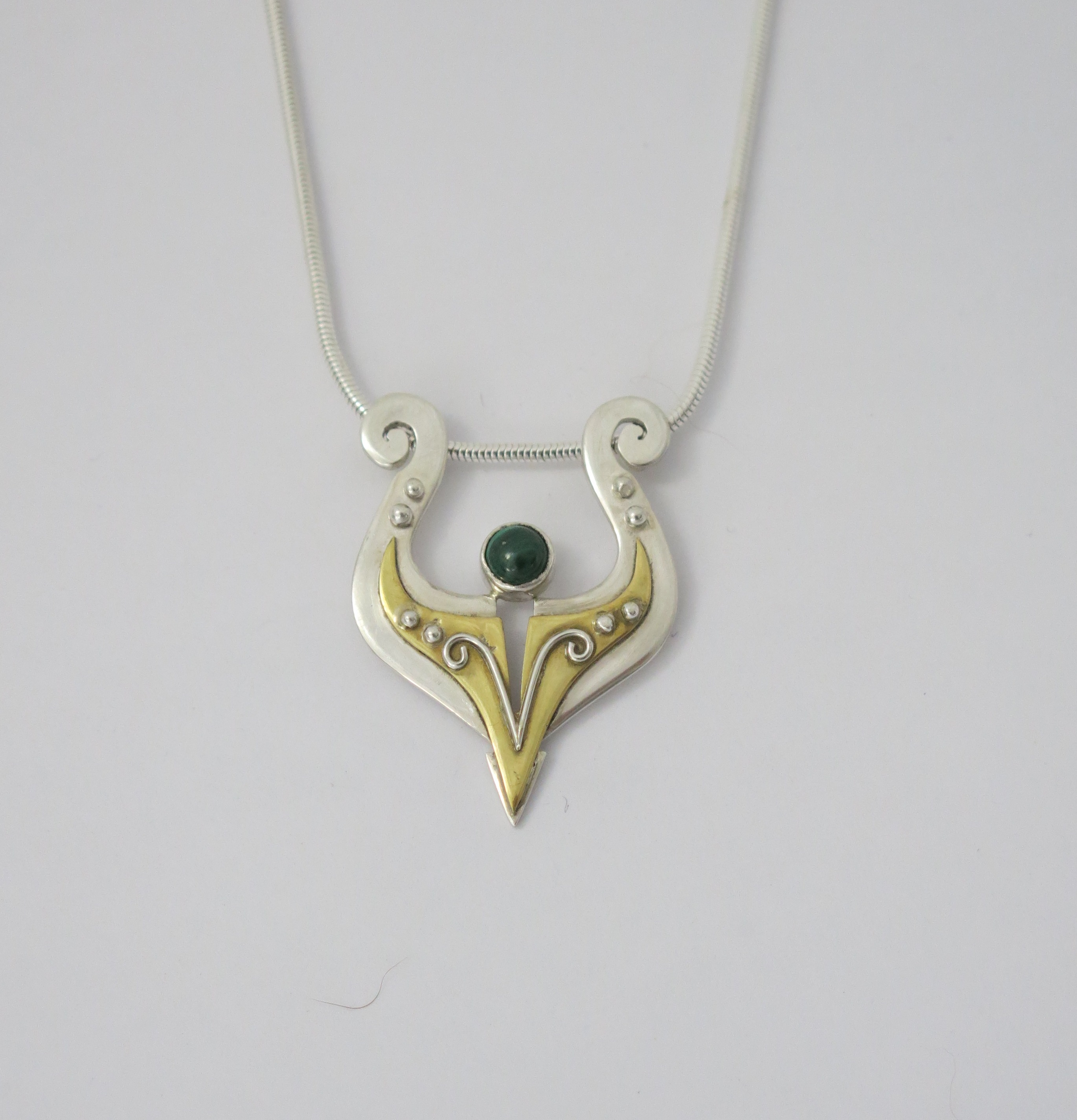 Silver and brass with malachite