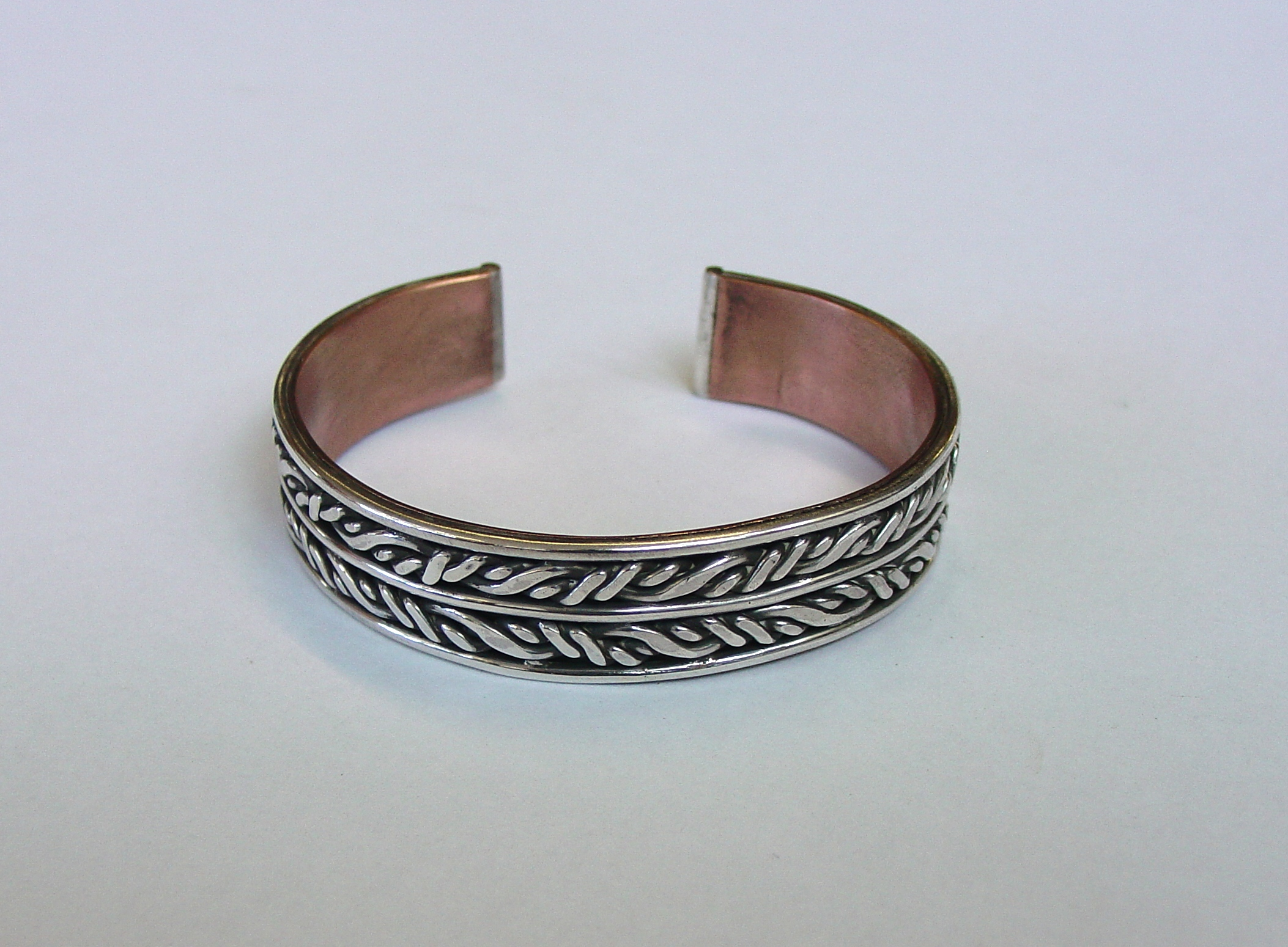 Silver twist bangle with copper backing