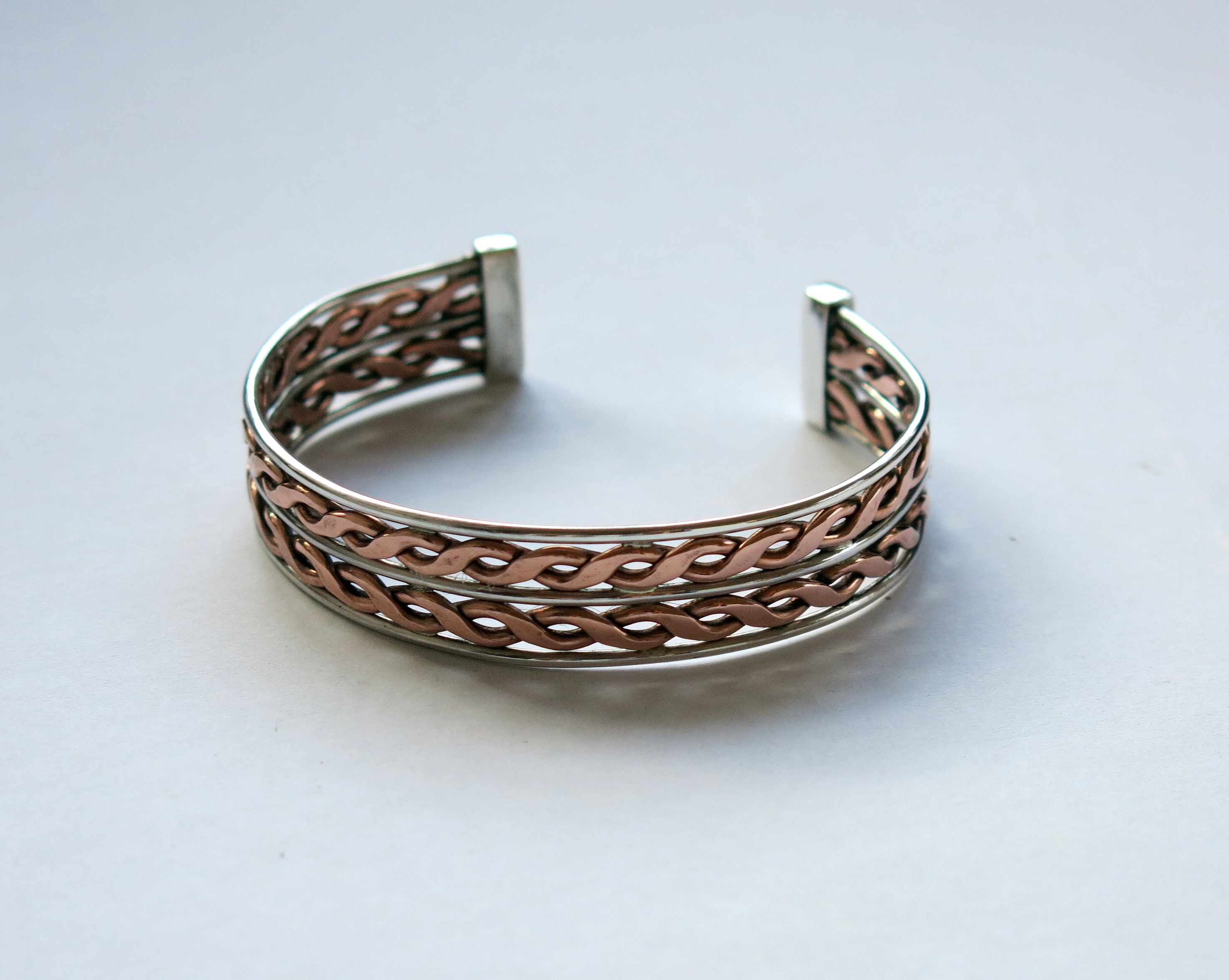 Double twist silver and copper bangle