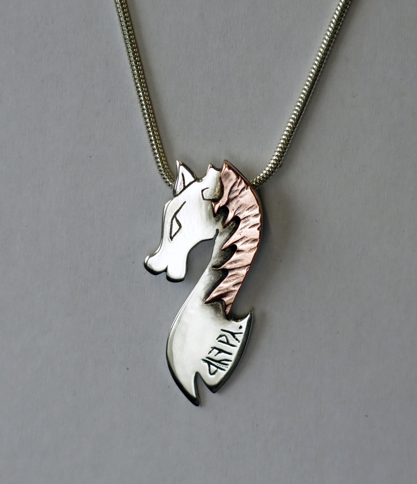 Silver and copper horse