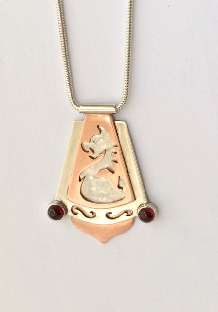 Silver and copper cut out animal