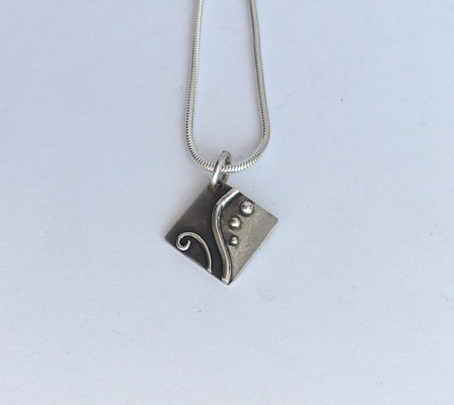 Silver pendant with black effect