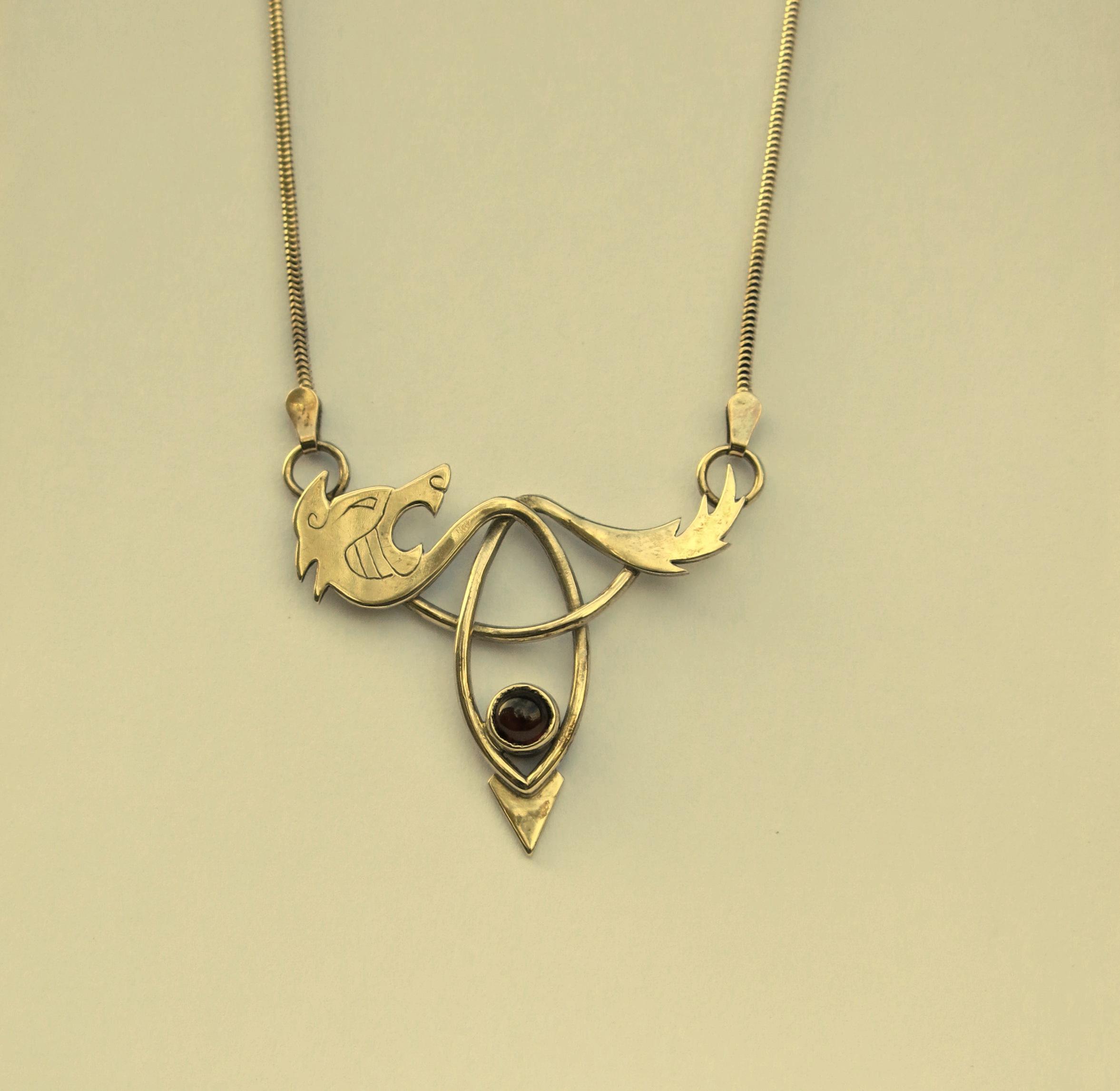 Wild beast with garnet pendant