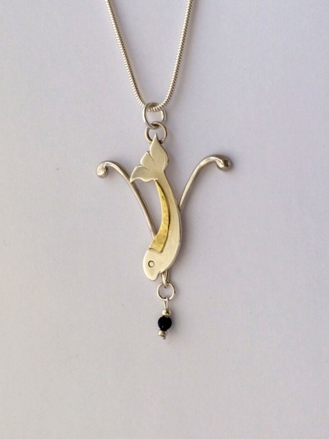 Silver and brass fish pendant