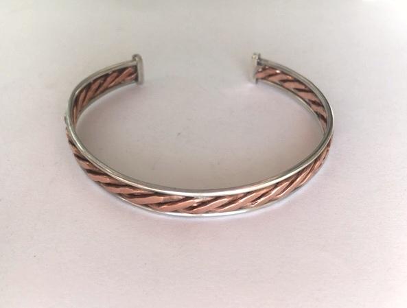 Silver and copper twist bangle