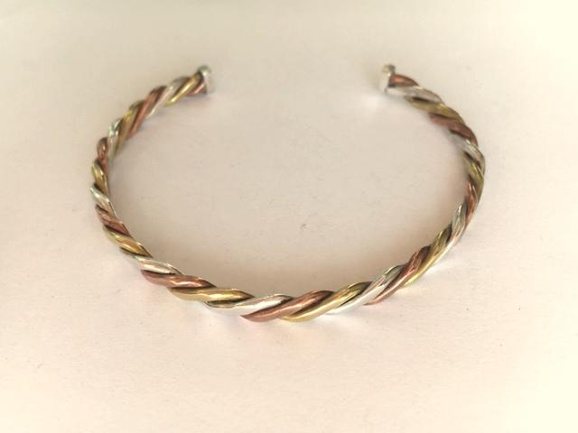 Silver, copper and brass twist bangle.