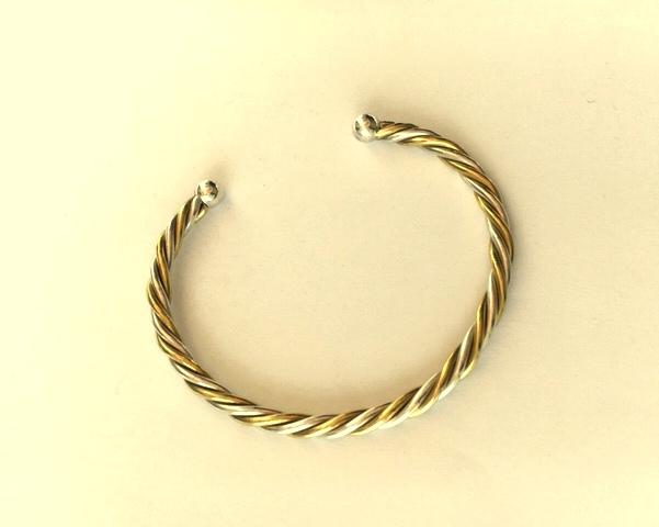 Silver and brass twist bangle