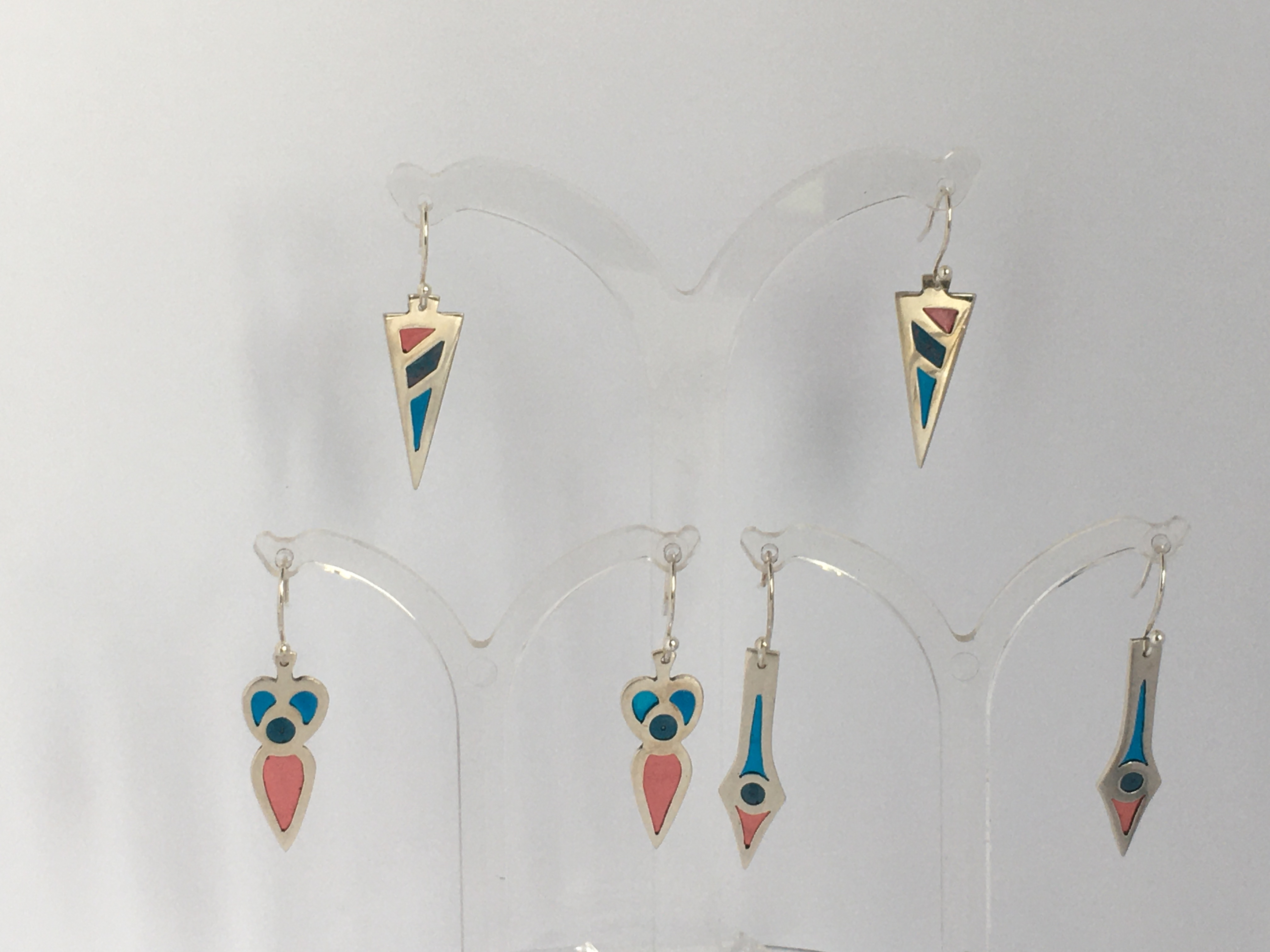 Silver earrings inset with coloured resin